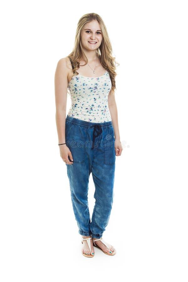Взгляд моды красивого подростка над белизной стоковое фото