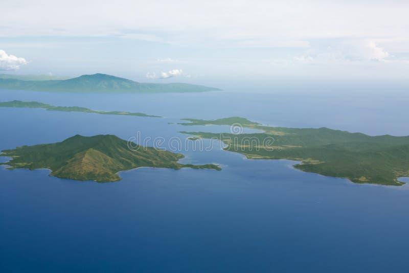 Взгляд островов от окна самолета стоковая фотография rf