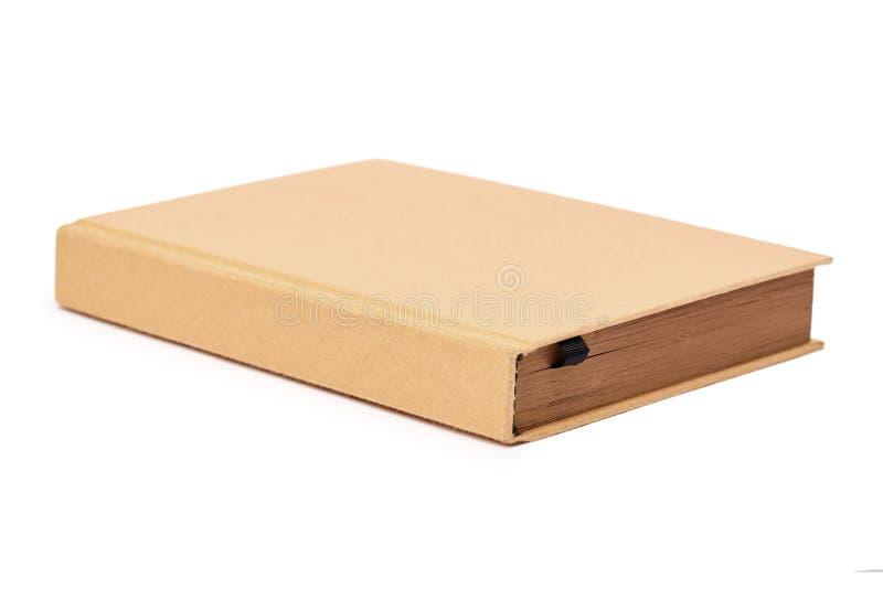 Взгляд перспективы насмешки закрытой книги вверх по коричневой крышке изолированной на белой предпосылке стоковое изображение