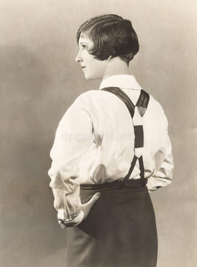Взгляд со стороны подтяжок женщины нося и брюк людей, 1920s стоковые фотографии rf