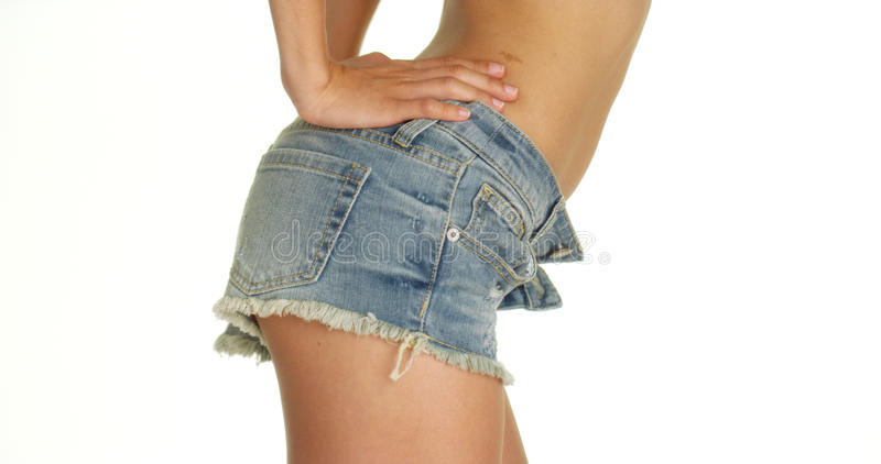 Взгляд со стороны шортов джинсовой ткани женщины нося стоковые фото