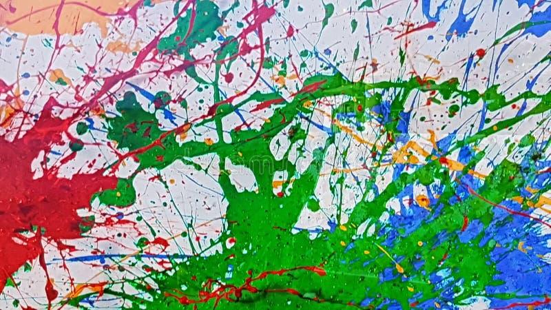взрыв краски зеленый и голубой стоковое фото rf