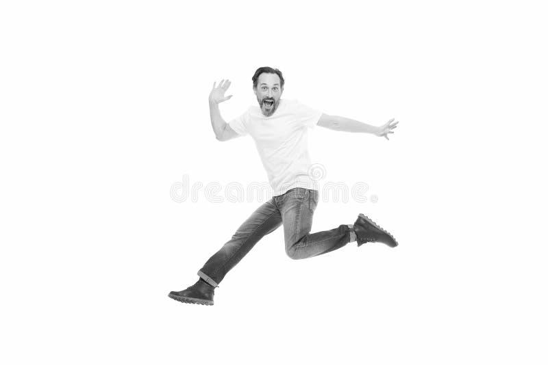 Взрыв положительных эмоций Человек возбудил скакать Зрелый харизматический диктор возбужденный для того чтобы сообщить Вполне обо стоковое фото rf