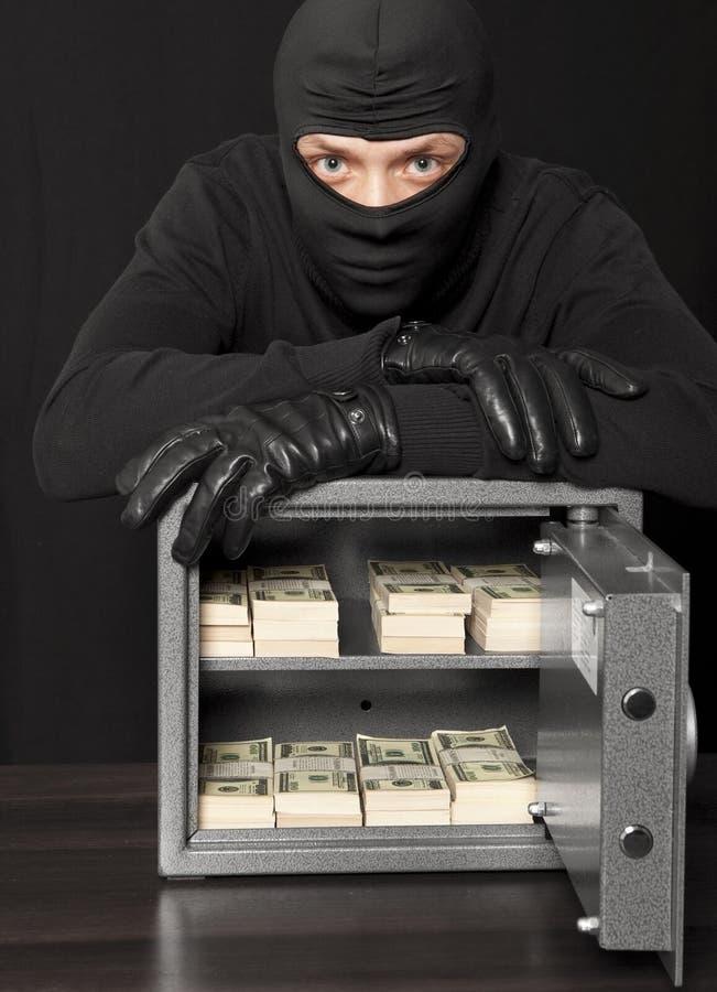 Взломщик похитителя и сейф дома стоковая фотография