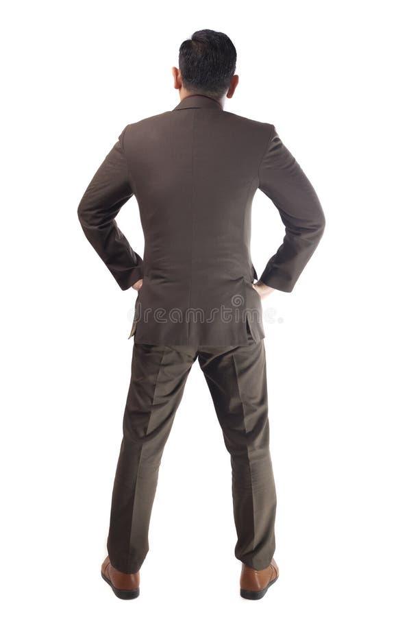 Вид сзади бизнесмена Полный портрет тела изолированный на белизне стоковое изображение