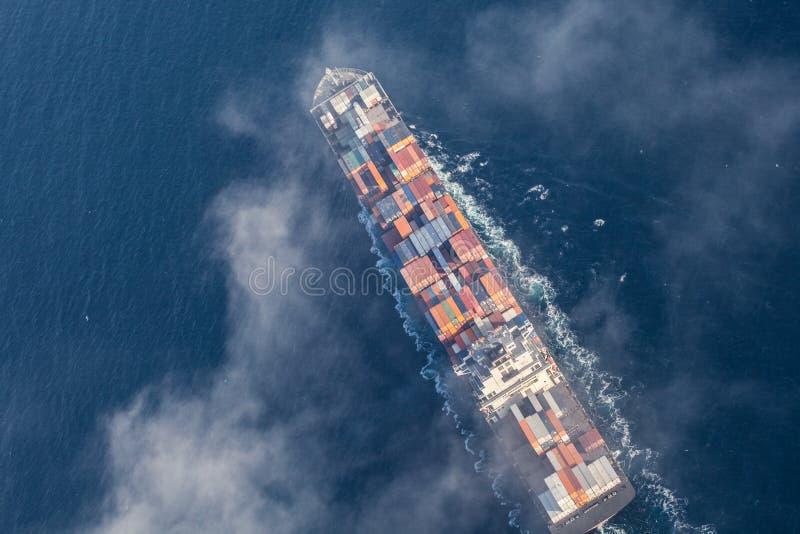Вид с воздуха грузового корабля на море стоковое фото rf