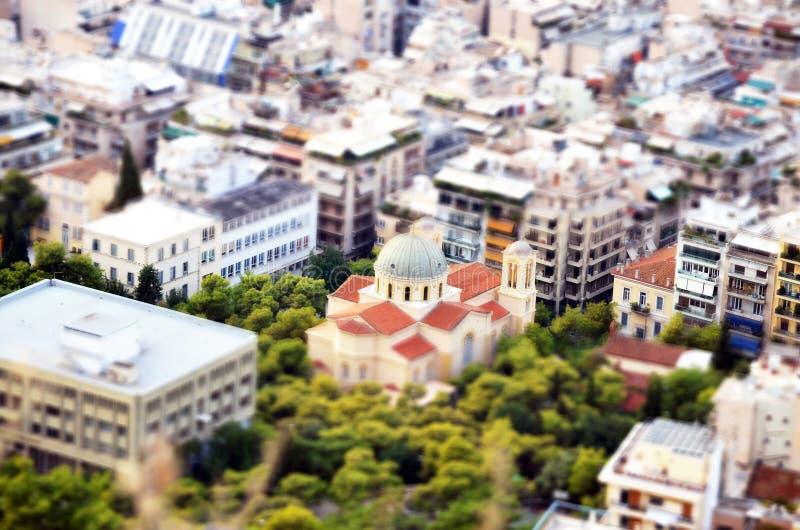 Вид с воздуха церков Nikolaos ажио от холма Lykavittos, с миниатюрным влиянием, в центе стоковое фото rf