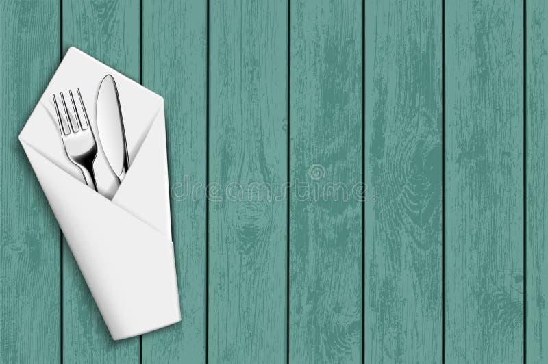 Вилка и нож в белой салфетке бесплатная иллюстрация