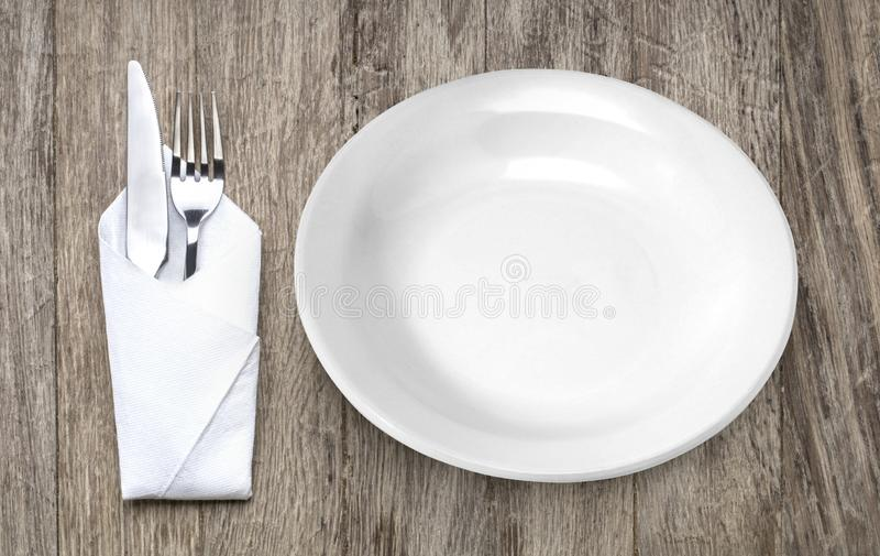 Вилка и нож металла на деревянном столе стоковое фото