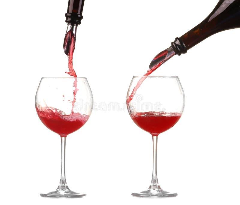 Вино коллажа красное лить в изолированный бокал стоковая фотография