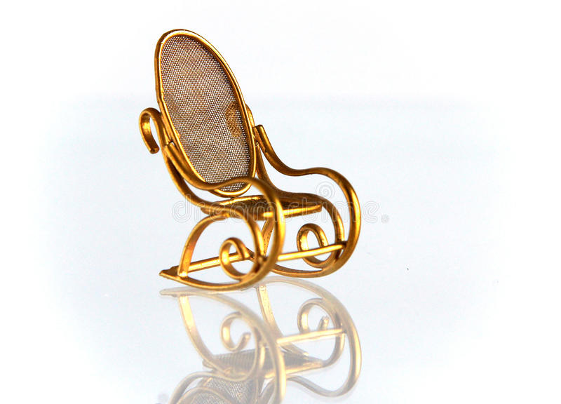 Винтажная латунная кресло-качалка стоковые изображения rf