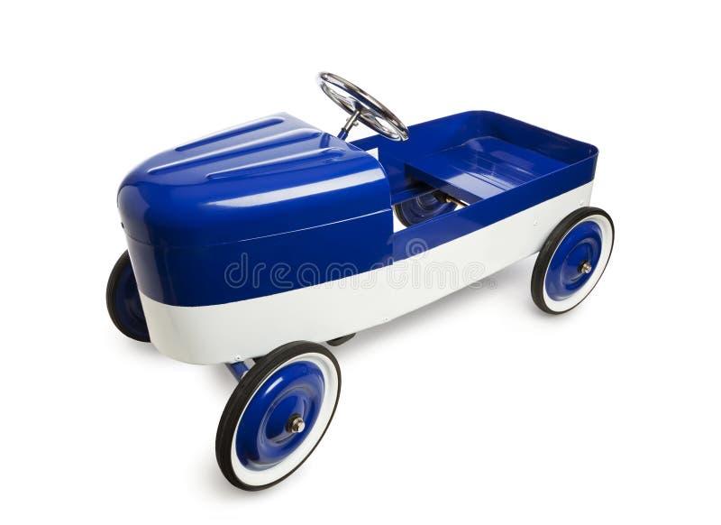 Винтажная игрушка автомобиля педали на белизне стоковое изображение rf