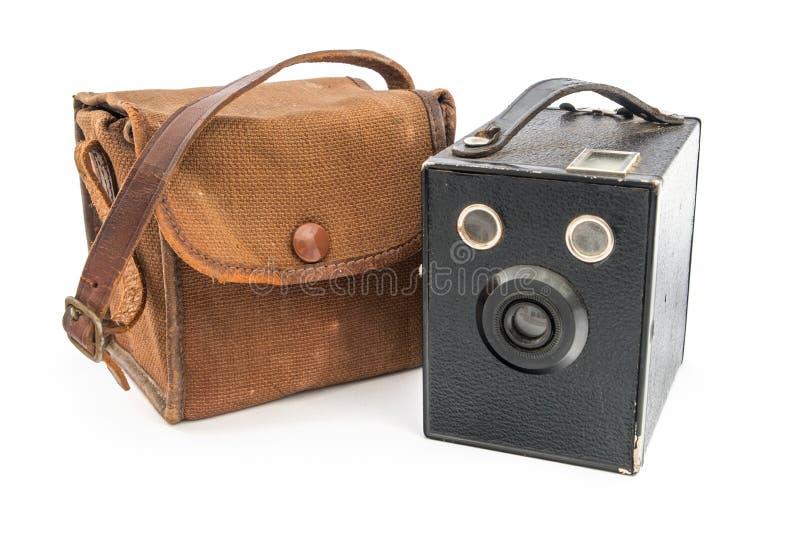 Винтажная камера и случай пирожного коробки стоковое изображение rf