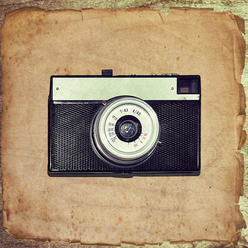 Винтажная камера на старой бумаге grunge стоковое фото