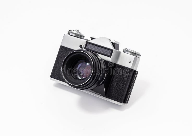 Винтажная камера фильма, конец-вверх на белой предпосылке, взгляд сверху стоковое фото