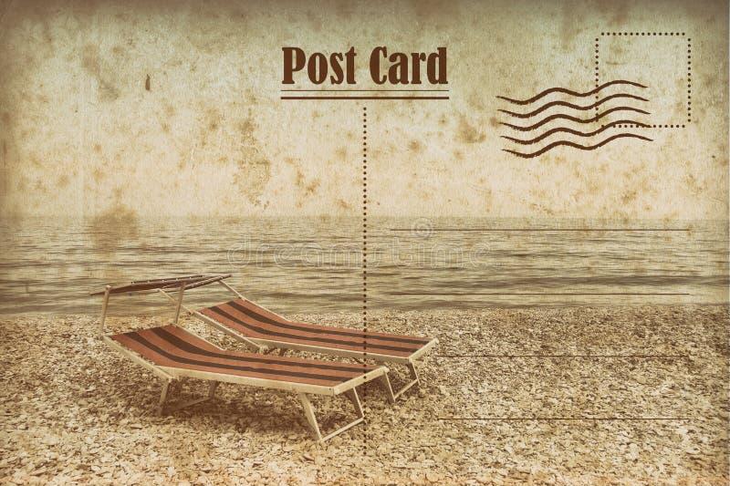 Винтажная открытка лета deckchair на пляже стоковое изображение