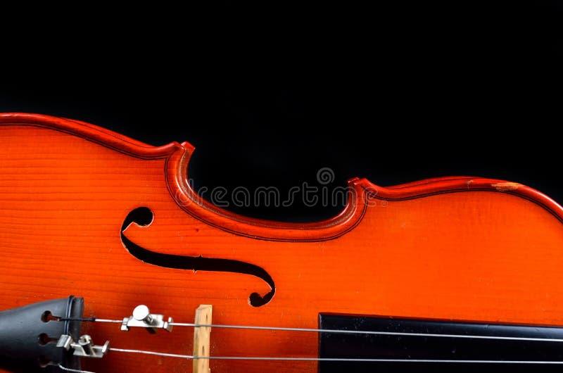 Винтажная скрипка на черной предпосылке стоковое фото rf