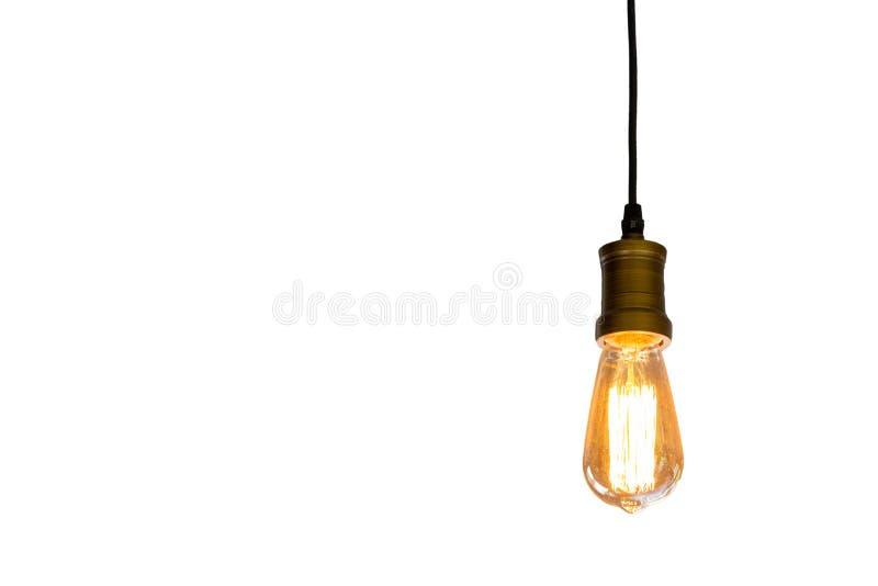 Винтажная электрическая лампочка вися изолированную белую предпосылку, conce идеи стоковые фото