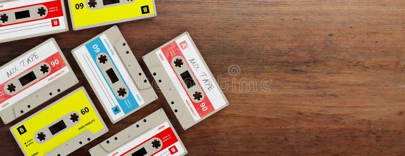 Винтажные магнитофонные кассеты на деревянной предпосылке, знамени, космосе экземпляра иллюстрация 3d иллюстрация штока