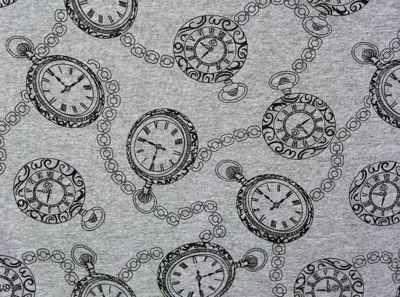 Винтажные часы кармана на текстуре ткани стоковое изображение rf