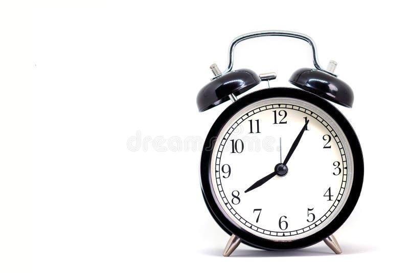 Винтажные черные часы, 8 часов 5 минут стоковое изображение rf