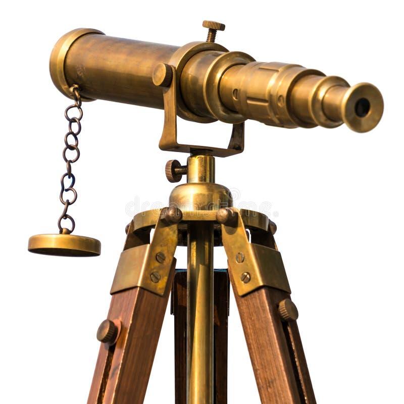 Винтажный латунный телескоп на белой предпосылке стоковое фото