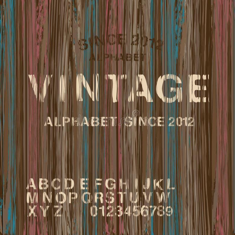 Винтажный алфавит штемпеля и деревянная предпосылка бесплатная иллюстрация