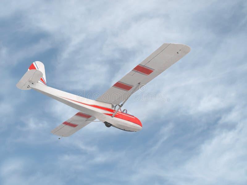 Винтажный планер в небе стоковое фото rf