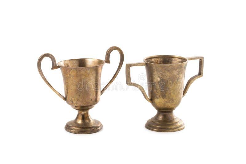 Винтажный старый золотой изолят чашки трофея на белой предпосылке стоковые изображения