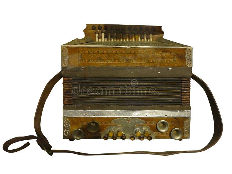 Винтажный старый коричневый деревянный аккордеон изолированный на белой предпосылке стоковые изображения