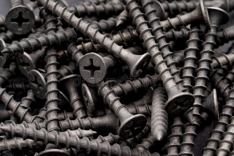 винты макроса темного drywall серые стоковая фотография rf