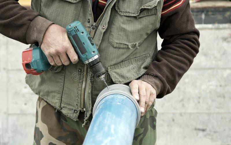 Download Винты отладки работника закрывают вверх Стоковое Изображение - изображение насчитывающей bores, мужчина: 40581475