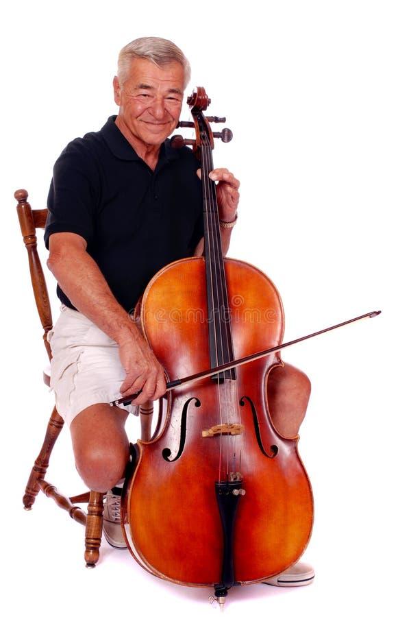виолончель играя старший стоковое фото rf