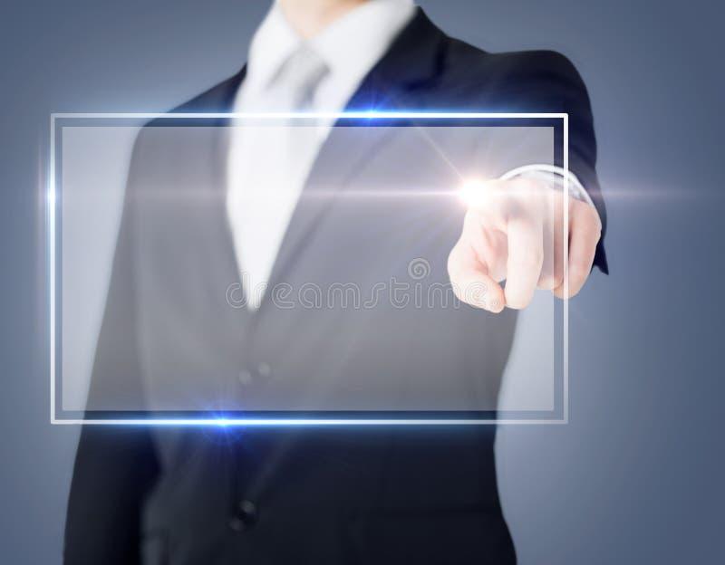 Виртуальный экран мужской руки касающий стоковое фото rf