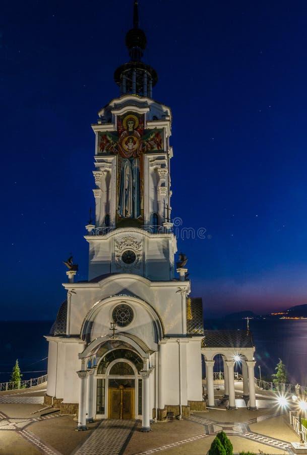 Висок маяка морем стоковое изображение