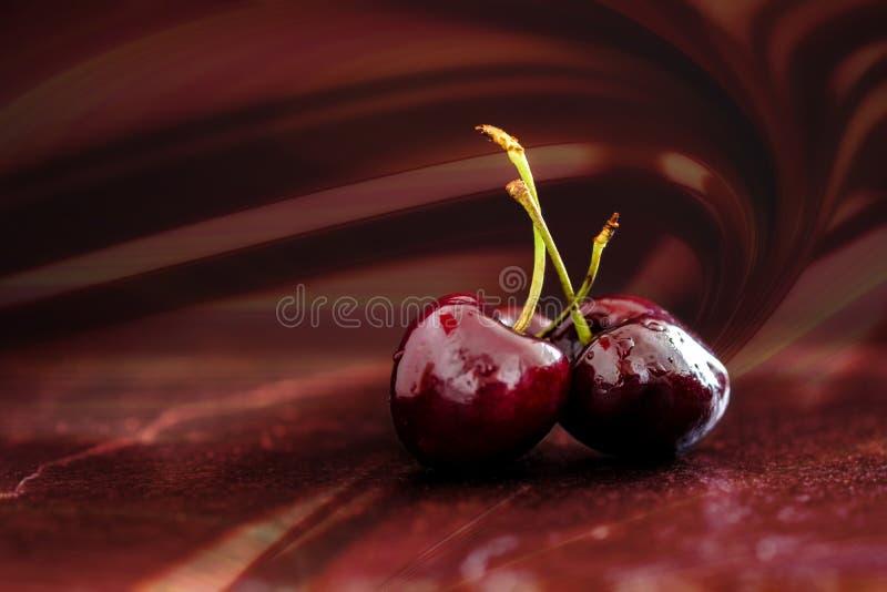 3 вишни на красной предпосылке стоковая фотография rf