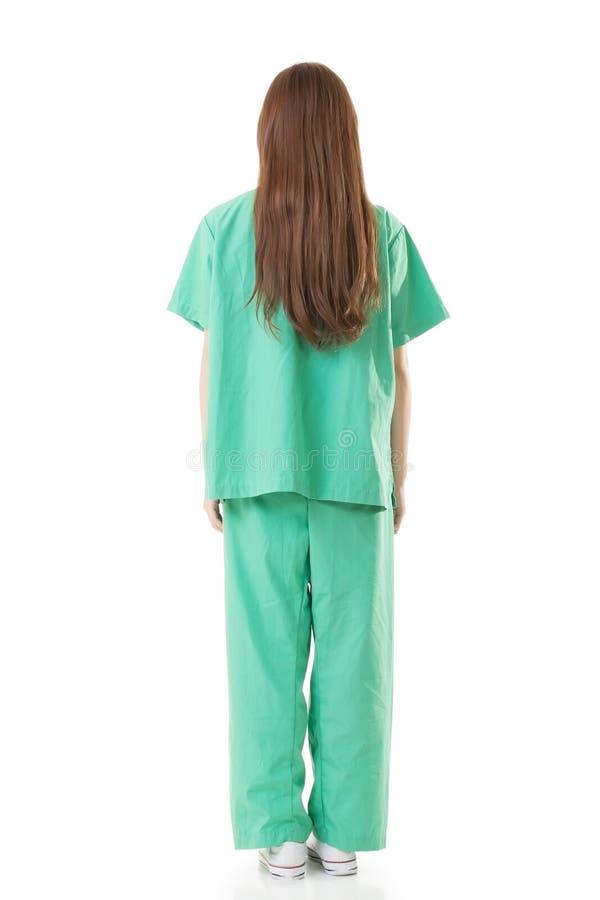 Вид сзади азиатской носки женщины доктора мантия или operati изоляции стоковая фотография rf
