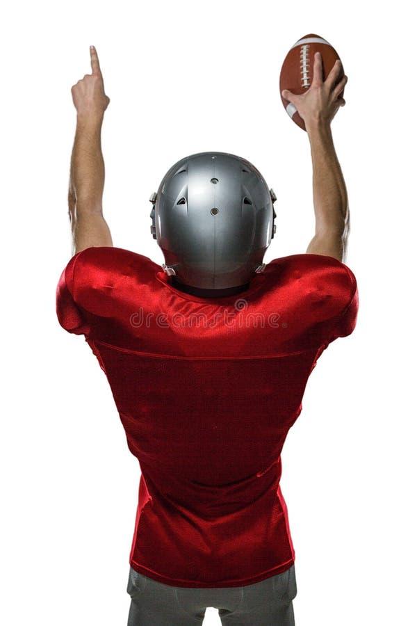 Вид сзади американского футболиста при поднятые оружия стоковое изображение