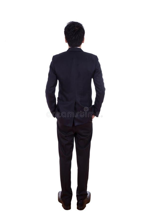 Вид сзади бизнесмена указывая на что-то, полнометражный iso стоковая фотография