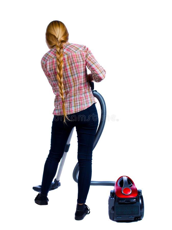 Вид сзади женщины с пылесосом стоковые фотографии rf
