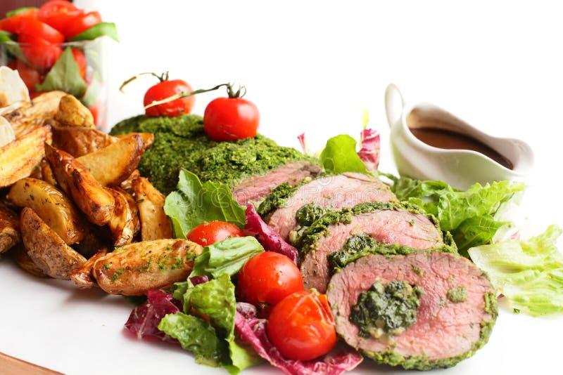 Вкусное мясо на белой предпосылке стоковые изображения