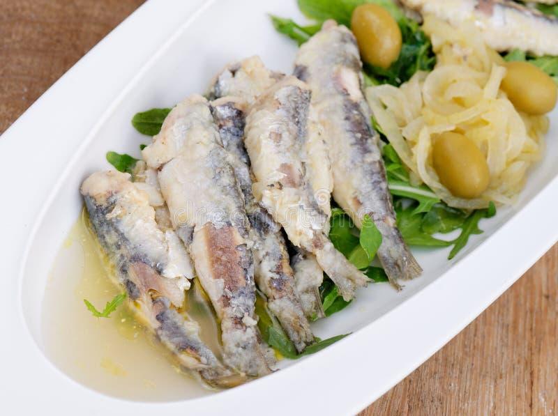 Вкусные Marinated сардины стоковая фотография