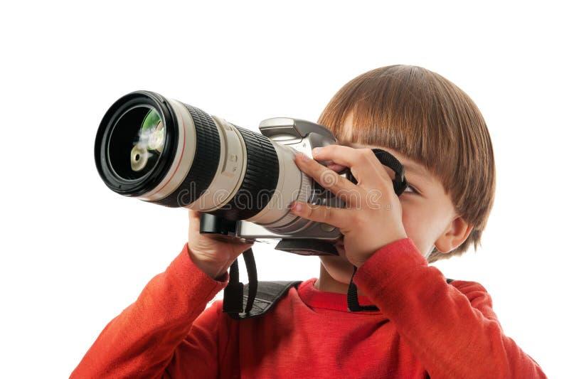 владения камеры мальчика стоковое фото