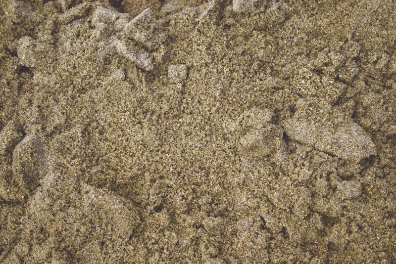 Влажная текстура песка Тема моря и океана Естественная предпосылка стоковая фотография