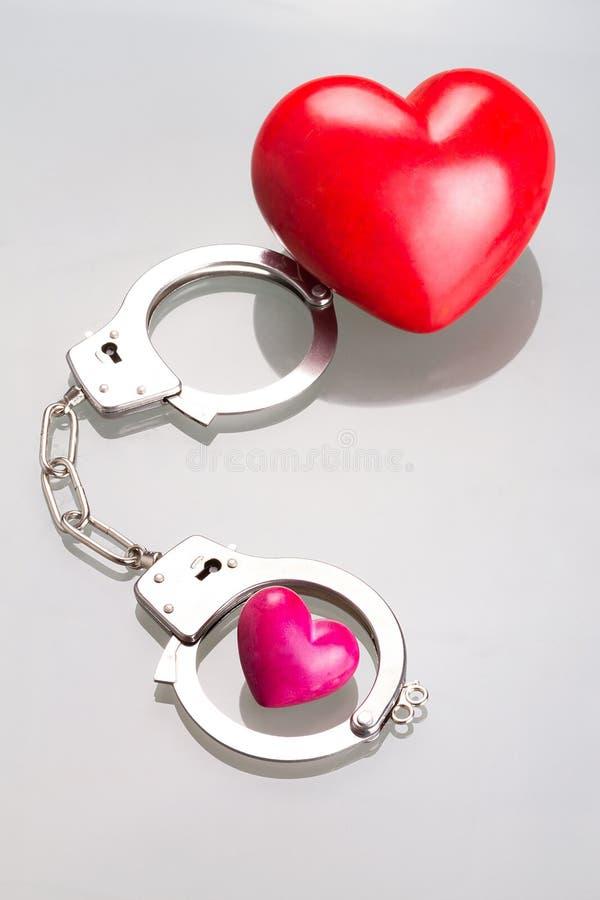 Влюбленность в наручниках Стоковая Фотография