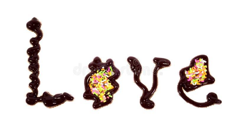 Влюбленность слова написанная шоколадом стоковое изображение rf