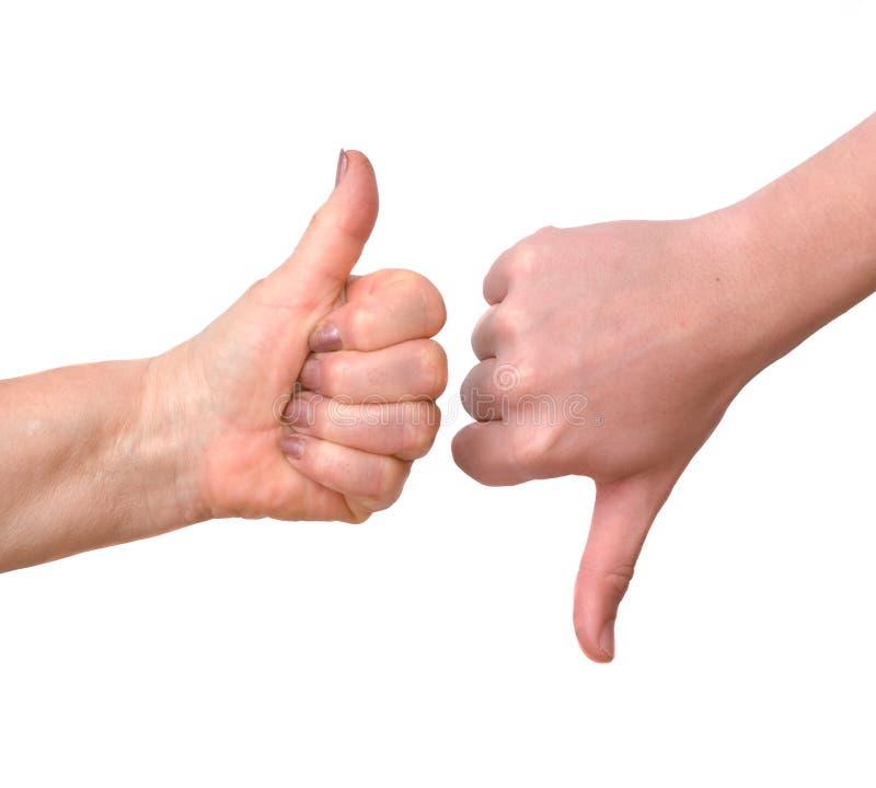 вниз вручает показывать большой пец руки вверх стоковая фотография