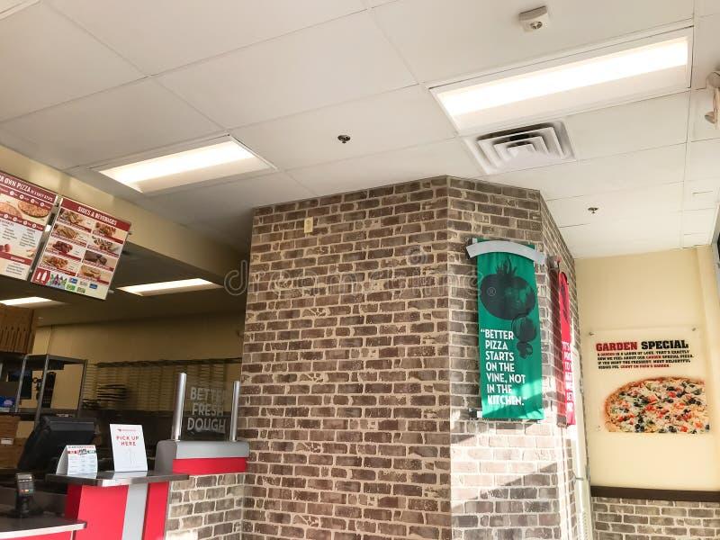Внутри сети ресторанов пиццы Джона папы американской в Техасе, Америка стоковое изображение rf