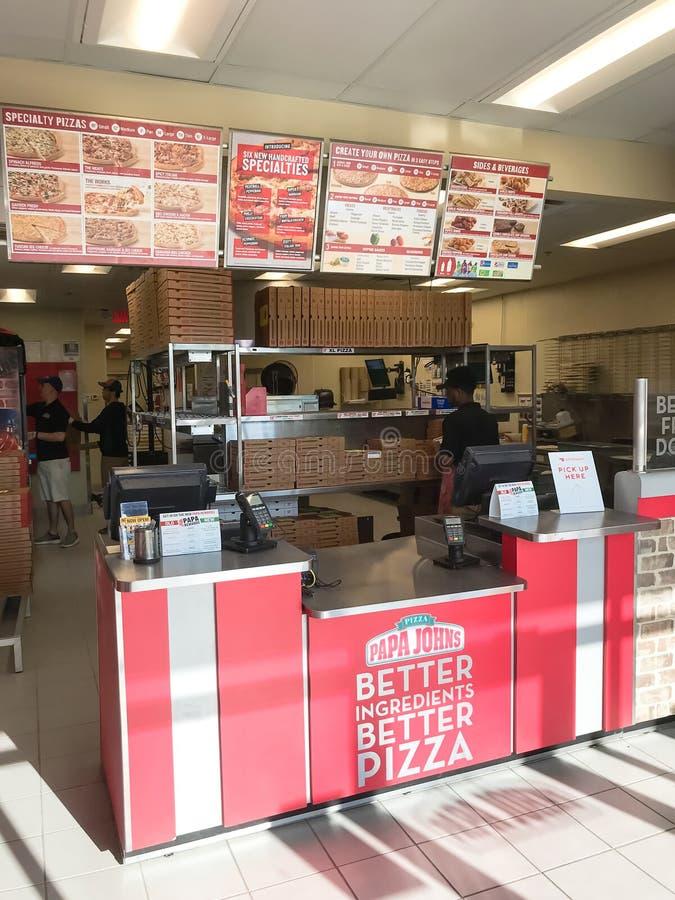 Внутри сети ресторанов пиццы Джона папы американской в Техасе, Америка стоковое фото