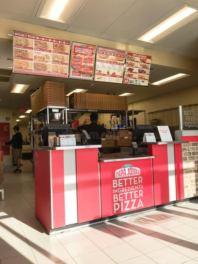 Внутри сети ресторанов пиццы Джона папы американской в Техасе, Америка стоковые фотографии rf